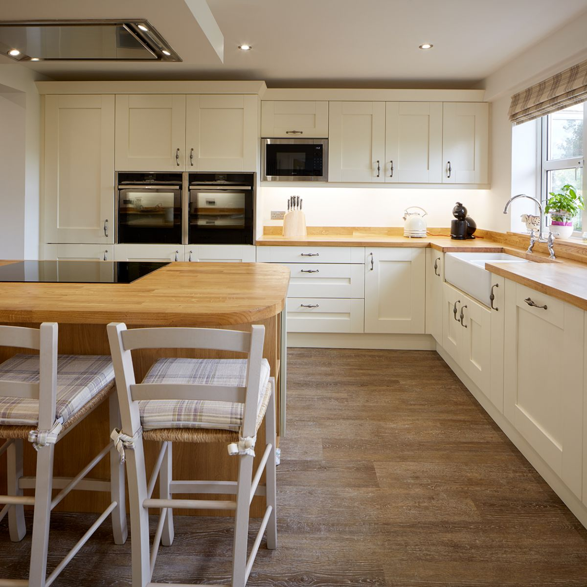 Hardwood worktops in a cream bespoke fitted kitchen.