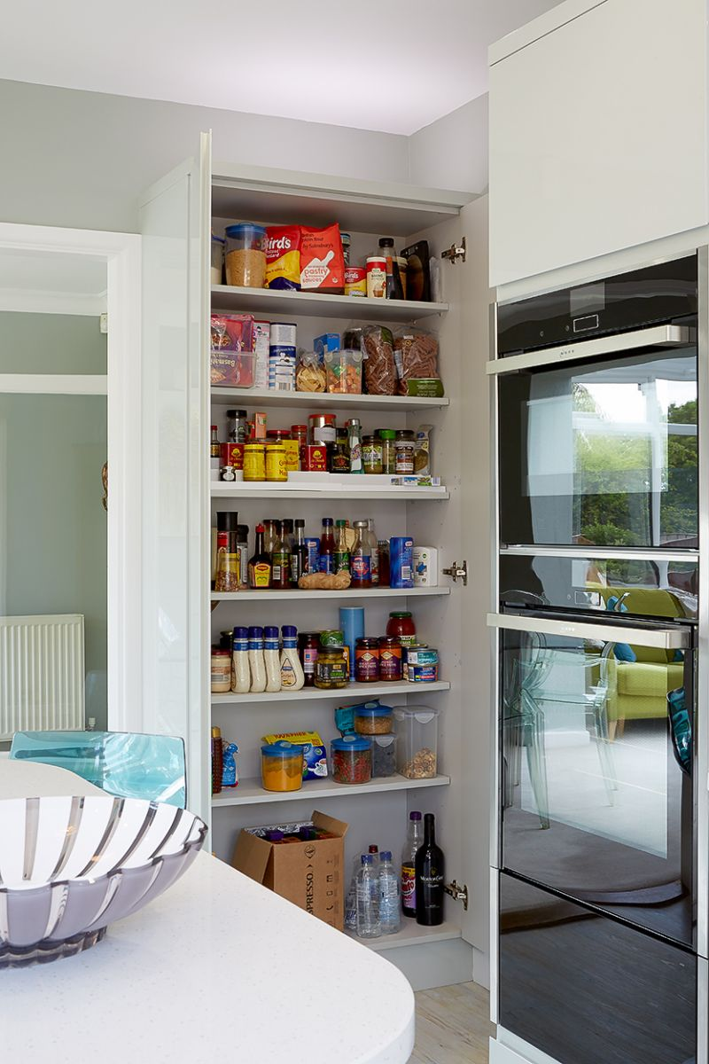 Storage cupboards alongside an integrated fridge freezer.