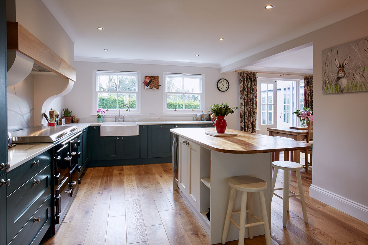 Natural light hitting the hardwood kitchen worktops.