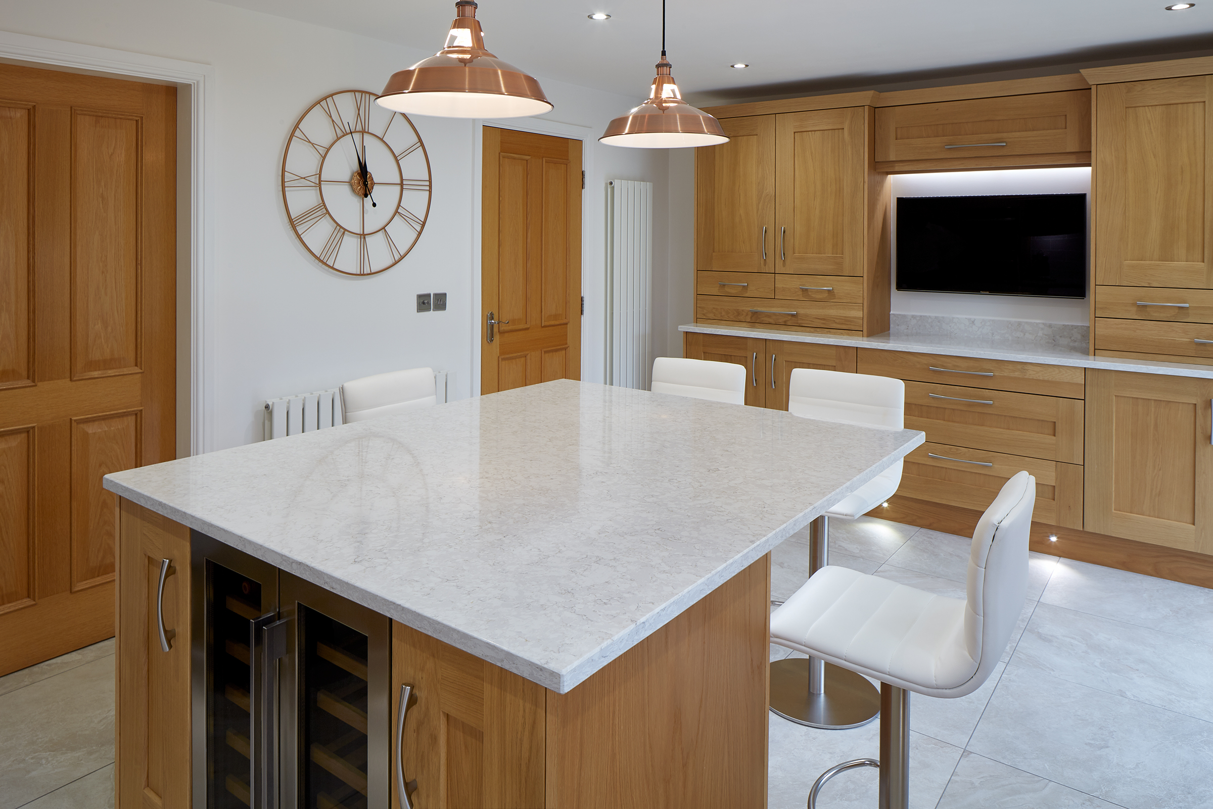 Full hardwood oak kitchen, with white granite worktops.